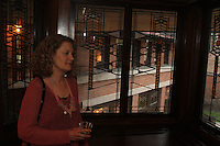 People came out Friday evening for the final After Hours event of April at the Robie where they were treated to food, music and tours of the historic house. The Robie House is located at 5757 S. Woodlawn.<br /> <br /> 2468 – Lanette Stigsen enjoys the view from one of the many decorated windows on the house.