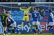 Macclesfield Town's Tyrone Marsh(8) heads the ball towards goal, saved by Forest Green Rovers goalkeeper Robert Sanchez(1) during the EFL Sky Bet League 2 match between Macclesfield Town and Forest Green Rovers at Moss Rose, Macclesfield, United Kingdom on 29 September 2018.