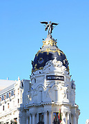 Metropolis building cupola dome with gold and winged angel, Madrid city centre, Spain, architects Jules and Raymond Février 1911