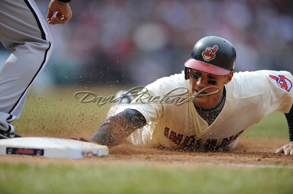 Grady Sizemore dives safely into first base on a pickoff attempt. The Cleveland Indians defeated the Chicago White Sox Monday, March 31 at Progressive Field in Cleveland. The Indians defeated the White Sox 10-8..