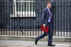 © Licensed to London News Pictures. 18/12/2018. London, UK. Secretary of State for Business, Energy and Industrial Strategy Greg Clark leaves 10 Downing Street after the Cabinet meeting. Tomorrow will mark 100 days to go before the 29 March 2019 deadline for leaving the European Union. Photo credit: Rob Pinney/LNP