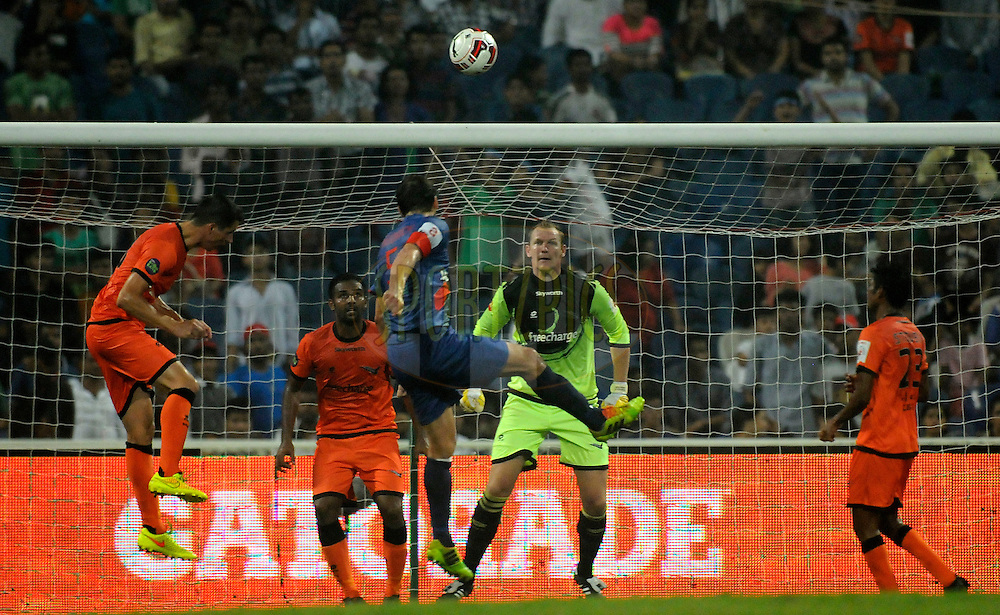Manuel Friedrich of Mumbai City FC takes a header during match 22 of the Hero Indian Super League between Mumbai City FC and Delhi Dynamos FC City held at the D.Y. Patil Stadium, Navi Mumbai, India on the 5th November.<br /> <br /> Photo by:  Pal Pillai/ ISL/ SPORTZPICS