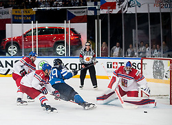 Tomas Plekanec of Czech Republic, Jesse Puljujarvi of Finland and  Petr Mrazek of Czech Republic during the 2017 IIHF Men's World Championship group B Ice hockey match between National Teams of Finland and Czech Republic, on May 8, 2017 in Accorhotels Arena in Paris, France. Photo by Vid Ponikvar / Sportida