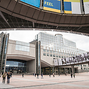 People walking in the main plaza in front of the European Parliament Building in Brussels, Belgium.