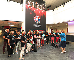CARDIFF, WALES - Saturday, June 4, 2016: The Tenovis Chior serenades the Wales team as they are given a colourful send off at Cardiff Airport as the squad head to Sweden for their last friendly before the UEFA Euro 2016 in France. (Pic by David Rawcliffe/Propaganda)