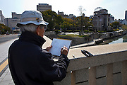 Japanese man schetching the A-Bomb Dome monument in Hiroshima