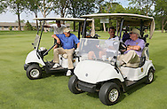 UNI men's basketball coach Ben Jacobson (second on right) talks with BJ Fleming (from left), of Robins, Bill Mowery, of Robins, and Pat Cobb, of Cedar Rapids while they wait to play a hole during the UNI Panther Prowl at Elmcrest Country Club, 1 Zach Johnson Dr NE, in Cedar Rapids on Monday afternoon, May 7, 2012. (Stephen Mally/Freelance)