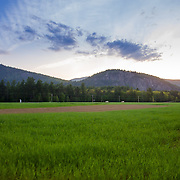 Springtime sunset over Cathedral Ledge and the Shartner Farm in North Conway, NH