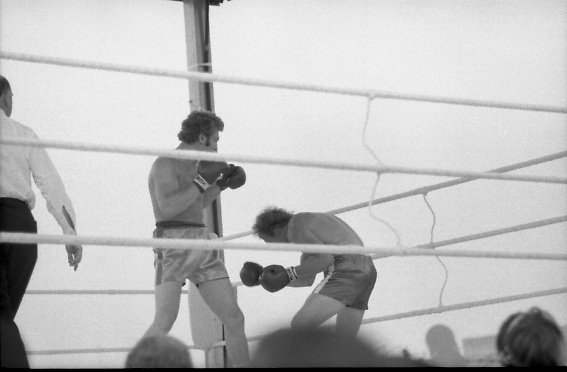 Ali vs Lewis Fight, Croke Park,Dublin..1972..19.07.1972..07.19.1972..19th July 1972..As part of his built up for a World Championship attempt against the current champion, 'Smokin' Joe Frazier,Muhammad Ali fought Al 'Blue' Lewis at Croke Park,Dublin,Ireland. Muhammad Ali won the fight with a TKO when the fight was stopped in the eleventh round...Photo shows Bugner in total control of the fight as neilson is hammered back.