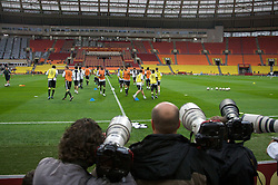 MOSCOW, RUSSIA - Tuesday, May 20, 2008: Photographers group together to get their shots of Chelsea players during training ahead of the UEFA Champions League Final against Manchester United at the Luzhniki Stadium. (Photo by David Rawcliffe/Propaganda)