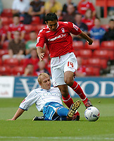 Photo: Leigh Quinnell.<br /> Nottingham Forest v Brighton & Hove Albion. Coca Cola League 1. 19/08/2006. Forests Jack Lester jumps a challenge from Brightons Richard Carpenter.