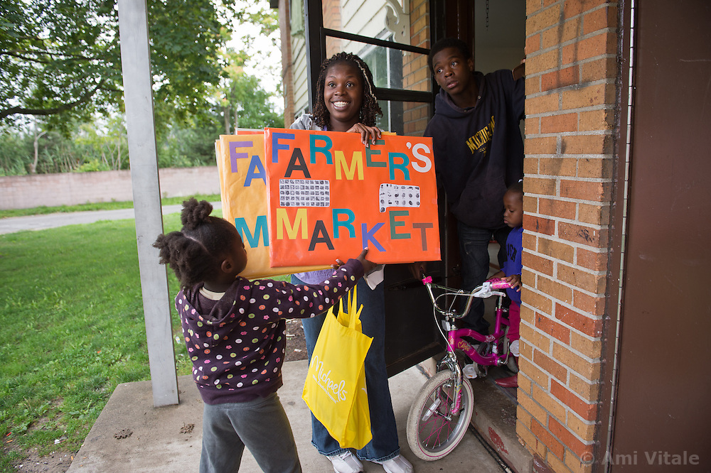 Alisha Winters takes her family Myshelle James, 4, (on bike) Deborah Smith 5, (left) and Robert Conner 3rd, 13, to the Farmers Market in River Rouge, Detroit. Her children suffer from asthma and she blames the industry and coal plants in River Rouge, Detroit, on their health problems.
