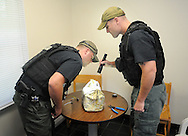 EDITORS NOTE: SHERIFF DECLINED TO IDENTIFY BOMB SQUAD MEMBERS: Montgomery County Sheriff's Office Bomb & Hazardous Device Disposal Unit members work to disarm a device during an emergency training exercise at Arcadia University's Crime Scene House in preparation for the Pope's visit to Philadelphia Wednesday August 12, 2015 in Cheltenham, Pennsylvania. (Photo by William Thomas Cain)