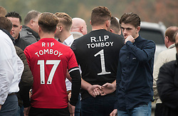 "© Licensed to London News Pictures. 26/10/2017. Epsom, UK. Two young men wearing ""R.I.P TOMBOY"" on the back of Manchester United football shirts. Funeral of Tom 'Tomboy' Doherty the nephew of Big Fat Gypsy Weddings star Paddy Doherty, at Epsom Cemetery in Epsom, Surrey. Tom Doherty was 17 when he was killed in a car crash in South Nutfield in Surrey on October 9. He had passed his driving test just days earlier. Photo credit: Ben Cawthra/LNP"