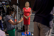 A foreign TV reporter updates news to her audience at home on developments of the Duchess of Cambridge's birth details.