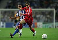 Photo: Paul Thomas.<br /> Porto v Liverpool. UEFA Champions League Group A. 18/09/2007.<br /> <br /> Fernando Torres (R) of Liverpool battles with Bosingwa.