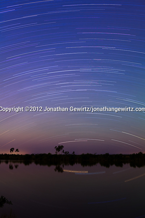 A one-hour time exposure reveals the movement of stars in the night sky over Sisal Pond in Everglades National Park, Florida. WATERMARKS WILL NOT APPEAR ON PRINTS OR LICENSED IMAGES.