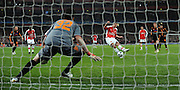 Robin Van Persie scores the winning Goal from the penalty spot during the UEFA Champions League First knockout round, First Leg match between Arsenal and A.S. Roma at Emirates Stadium on February 24, 2009 in London, England