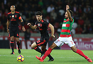 Benfica's player Gonçalo Guedes (L ) fights for the ball with Maritimo´s player Maurício   (R ) during Portuguese First League football match C.S. Maritimo vs S.L. Benfica held at Barreiros Stadium, Funchal, Portugal, 01 December, 2016.
