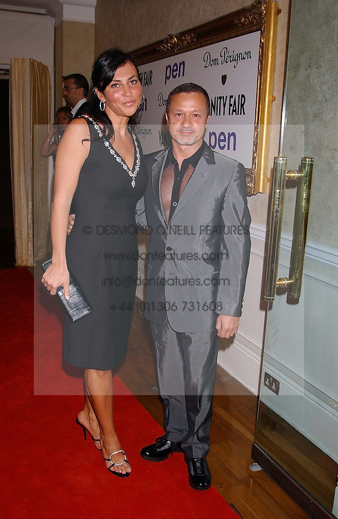 ELLA KRASNER and JACQUES AZAGURY at a party hosted by Dom Perignon and Vanity Fair magazine to celebrate the launch of a unique collection of essays based on the theme of seduction to raise money for the charity English Pen. The paty was held at the Dom Perignon Mallroom,  13 Grosvenor Crescent, London W1 on 8th September 2004.