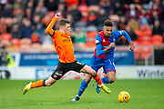 Jamie Robson (#17) of Dundee United FC tackles Nathan Austin (#9) of Inverness Caledonian Thistle FC during the William Hill Scottish Cup quarter final match between Dundee United and Inverness CT at Tannadice Park, Dundee, Scotland on 3 March 2019.