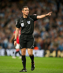 MANCHESTER, ENGLAND - Monday, April 30, 2012: Referee Andre Marriner takes charge during the Premiership match at the City of Manchester Stadium. (Pic by Chris Brunskill/Propaganda)