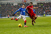 Ryan Kent of Rangers crosses the ball in front of Graeme Shinnie of Aberdeen FC during the William Hill Scottish Cup quarter final replay match between Rangers and Aberdeen at Ibrox, Glasgow, Scotland on 12 March 2019.