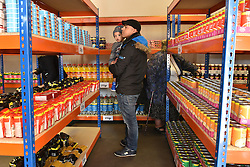 © Licensed to London News Pictures. 02/02/2016. London, UK. Customers shopping inside The new easyFoodstore budget Supermarket in Park Royal, north London which is selling a range of food products all at 25p each. The discount shop, which is owned by the EasyJet company, offers shoppers groceries ranging from pasta to beans to cleaning products. Fresh meat, fruit and vegetables are not yet available. Photo credit: Ray Tang/LNP