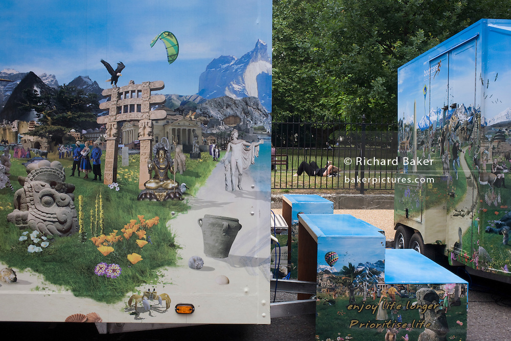 Incongruous and confusing landscape of natural world printed on to private healthcare trailer and safety barrier.