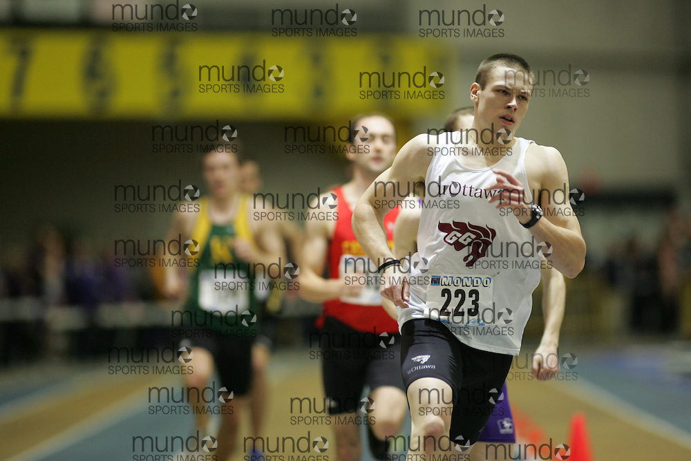 (Windsor, Ontario---13 March 2010) Michael Robertson of University of Ottawa Gee-Gees   competes in the men's 600m final at the 2010 Canadian Interuniversity Sport Track and Field Championships at the St. Denis Center. Photograph copyright Sean Burges/Mundo Sport Images. www.mundosportimages.com