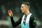 Ciaran Clark (#2) of Newcastle United signals to the bench for a water bottle at a stoppage in play during the Premier League match between Newcastle United and Chelsea at St. James's Park, Newcastle, England on 18 January 2020.