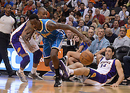 Apr 7, 2013; Phoenix, AZ, USA; Phoenix Suns forward Luis Scola (14) falls after diving for the ball as New Orleans Hornets guard Roger Mason Jr. (8) chases for the loose ball in the first half at US Airways Center. Mandatory Credit: Jennifer Stewart-USA TODAY Sports