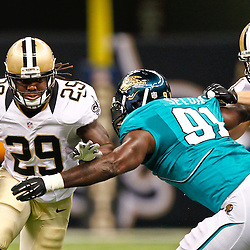 August 17, 2012; New Orleans, LA, USA; New Orleans Saints running back Chris Ivory (29) runs past Jacksonville Jaguars defensive end George Selvie (91) during the second half of a preseason game at the Mercedes-Benz Superdome. The Jaguars defeated the Saints 27-24.  Mandatory Credit: Derick E. Hingle-US PRESSWIRE