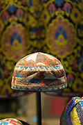 Turkish Muslim prayer caps kufi prayer skullcap or taqiyah (tagiya) in shop window in Istanbul, Republic of Turkey