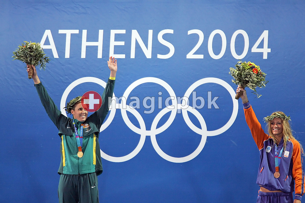 Petria Thomas (L) of Australia jubilates on the podium after she won the women's swimming 100 metre butterfly final held at the National Aquatics Center at the Athens 2004 Summer Olympic Games in Athens, Greece, Sunday, Aug. 15, 2004. Netherland's Inge de Bruijn (R) finished third. (Photo by Patrick B. Kraemer / MAGICPBK)