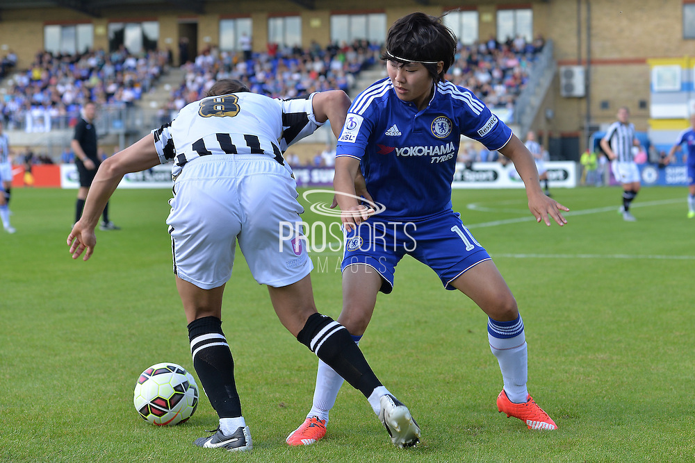 Notts County Ladies forward Rachel Williams goes past Chelsea Ladies midfielder Ji So-Yun during the FA Women's Super League match between Chelsea Ladies FC and Notts County Ladies FC at Staines Town FC, Staines, United Kingdom on 6 September 2015. Photo by Mark Davies.