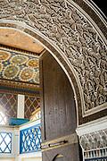 Moroccan zellije mosaic wall / doorway tiling, Bahia Palace, Marrakesh, Morocco, 2018-04-25.