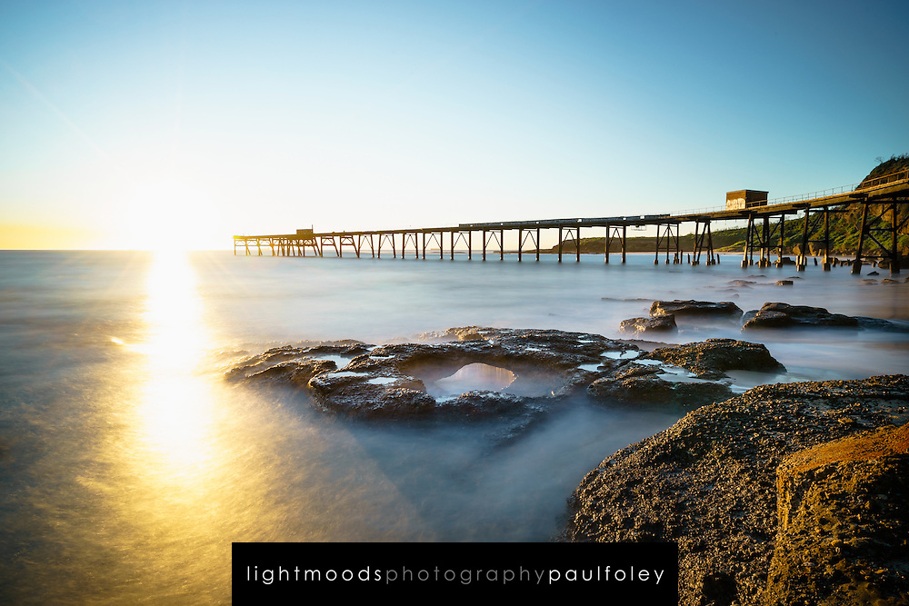 Sunrise over coal loading jetty at Catherine Hill Bay, NSW, Australia