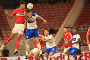 Ashley Fletcher heads clear under pressure from Ryan Delaney during the second round of the Carabao EFL Cup match between Middlesbrough and Rochdale at the Riverside Stadium, Middlesbrough, England on 28 August 2018.