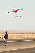Israel, Massada Air Strip, the international radio controlled model aircraft competition June 27 2009. The controller and his plane