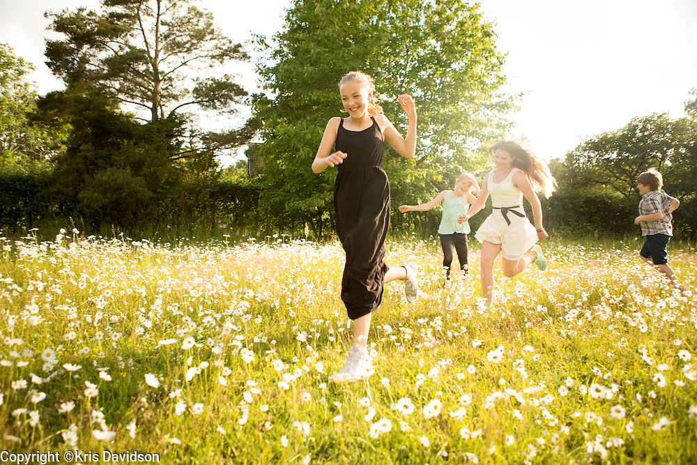 Children playing in a meadow on Öland, a Swedish island in the Baltic Sea on Midsummer Day. The longest day of the year is a beloved holiday in Sweden; the cities are empty as the locals take to the countryside for a day of dancing and singing with family and friends.