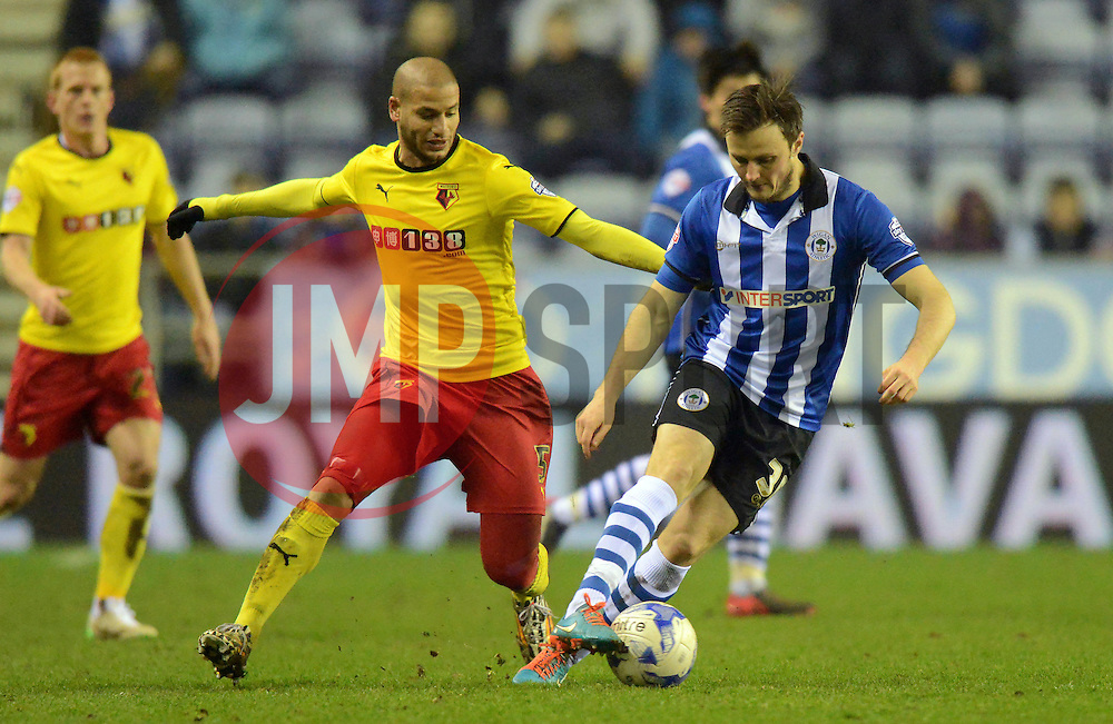 /Watford's Keith Andrews competes with Wigan's William Kvist - Photo mandatory by-line: Richard Martin-Roberts/JMP - Mobile: 07966 386802 - 17/03/2015 - SPORT - Football - Wigan - DW Stadium - Wigan Athletic  v Watford - Sky Bet Championship