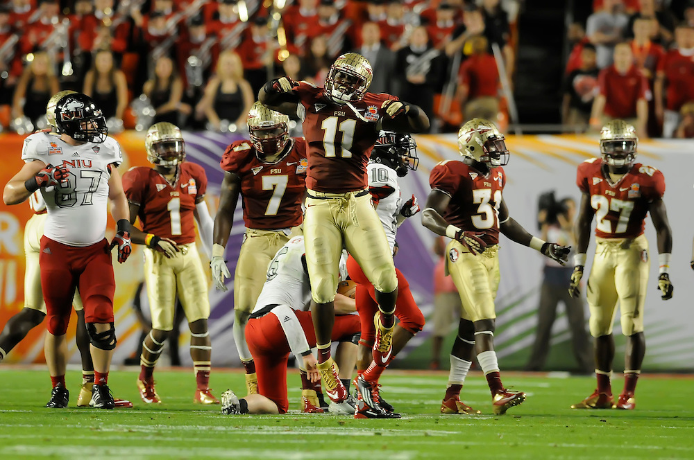 January 1, 2013: Vince Williams #11 of Florida State celebrates after making a play during the NCAA football game between the Northern Illinois Huskies and the Florida State Seminoles at the 2013 Orange Bowl in Miami Gardens, Florida. The Seminoles defeated the Huskies 31-10.
