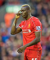 25.10.2014, Anfield, Liverpool, ENG, Premier League, FC Liverpool vs Hull City, 9. Runde, im Bild Liverpool's Mario Balotelli gestures to the linesman after his appeal for a penalty was ignored // 15054000 during the English Premier League 9th round match between Liverpool FC and Hull City at the Anfield in Liverpool, Great Britain on 2014/10/25. EXPA Pictures © 2014, PhotoCredit: EXPA/ Propagandaphoto/ David Rawcliffe<br /> <br /> *****ATTENTION - OUT of ENG, GBR*****
