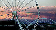 A bird flies around the Seattle Great Wheel at sunset, seen from the riverside on Alaskan Way. (Bettina Hansen/The Seattle Times)