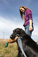 Emy Marier and her Flat-coated retriever, Lux.