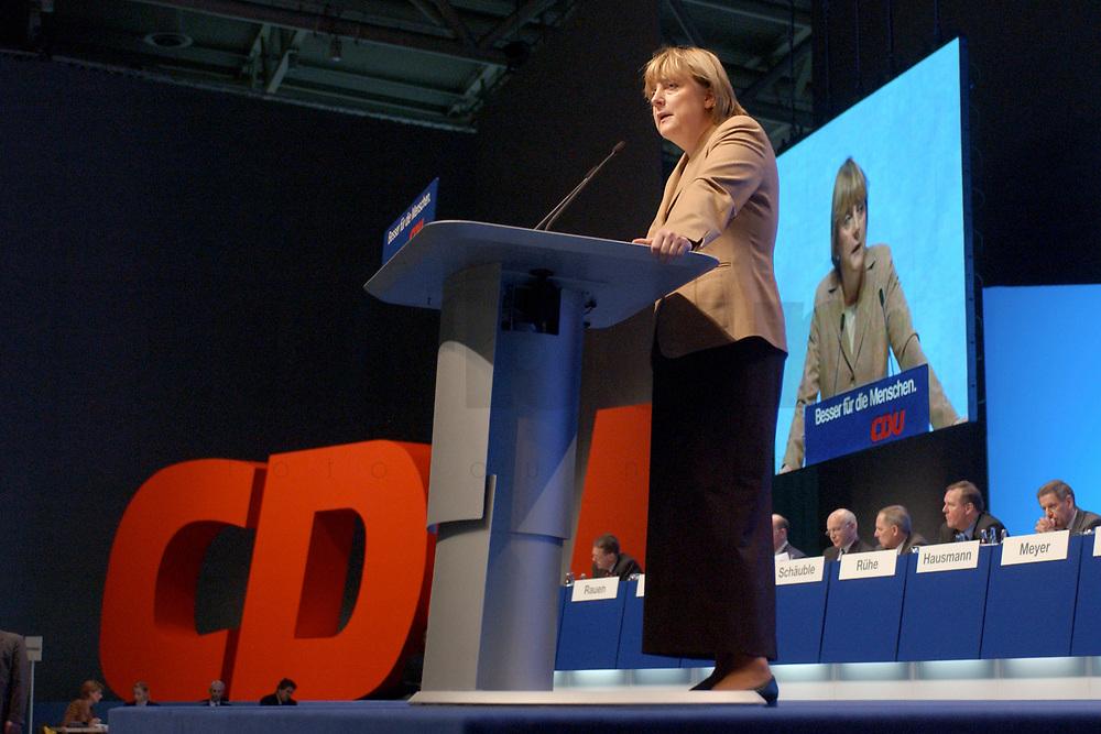 11 NOV 2002, HANNOVER/GERMANY:<br /> Angela Merkel, CDU Bundesvorsitzende, waehrend ihrer Rede, CDU Bundesparteitag, Hannover Messe<br /> IMAGE: 20021111-01-040<br /> KEYWORDS: Parteitag, party congress, speech, Logo, sign