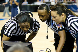 March 29, 2010; Sacramento, CA, USA; NCAA officials Felicia Grinter (left) and Lisa Jones (center) and Cameron Inouye (right) review video footage of the game winning shot as time expired by Stanford Cardinal guard Jeanette Pohlen (not pictured) during the second half against the Xavier Musketeers in the finals of the Sacramental regional in the 2010 NCAA womens basketball tournament at ARCO Arena. Pohlen scored as time ran out and Stanford defeated Xavier 55-53.