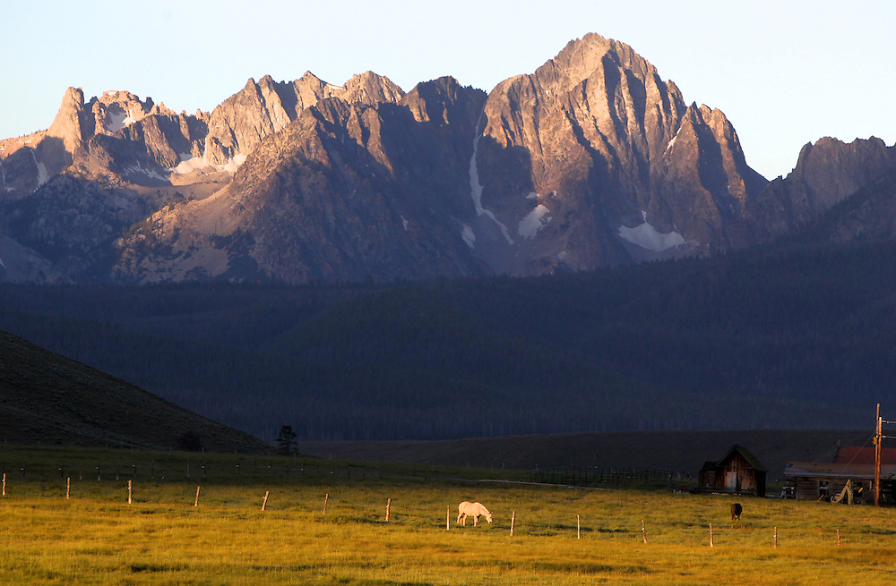The sun rises on the Sawtooth Mountains in central Idaho near the town of Stanley.