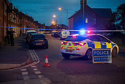 © Licensed to London News Pictures. 22/07/2020. Thame, UK. A police vehicle forms a cordon on Chinnor Road in Thame. Thames Valley Police has launched a murder investigation in Thame. At approximately  19:05BST a man was found with injuries in Chinnor Road, Thame. The 20-year-old man was pronounced dead at the scene. Photo credit: Peter Manning/LNP